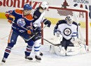 Winnipeg Jets goalie Edward Pasquale (32) makes a save as Jacob Trouba (3) and Edmonton Oilers Jesse Joensuu (6) watch during the second period of an NHL hockey preseason game Monday, Sept. 23, 2013, in Edmonton, Alberta.. (AP Photo/The Canadian Press, Jason Franson)