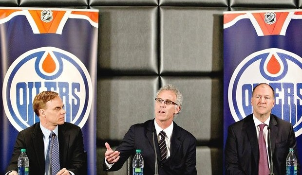 Edmonton Oilers new senior vice-president Scott Howson, left, new general manager Craig MacTavish and team president Kevin Lowe (right)attend a press conference in Edmonton, Alta., on Monday April 15, 2013. THE CANADIAN PRESS/Jason Franson